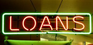 loan sign illuminates the consequences of refinancing or consolidation on credit scores