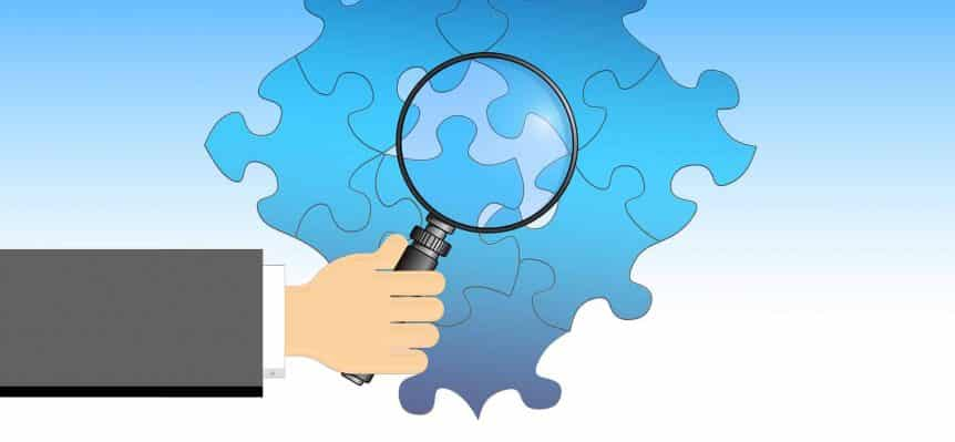 magnifying glass looking at the parts representing an income share agreement