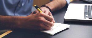 man writes down bar study loan options on napkin