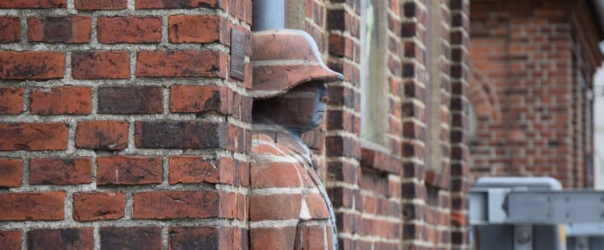 man hidden in bricks